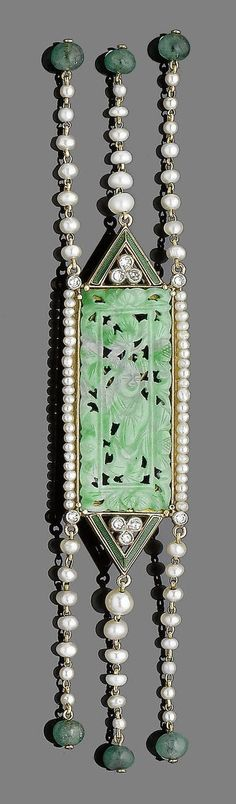 A jade, seed pearl and emerald brooch  The pierced rectangular jade plaque, carved with a Buddha within a foliate surround, to a border of seed pearls and single-cut diamonds, suspending rows of seed pearls, each terminating in an emerald bead, jade untested, length 13.2cm