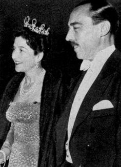 The royal couple arrive for a grand gala banquet thrown in 1955 by TM King Umberto II and Queen Maria José of Italy in Estoril on the occasion of the wedding of HRH Princess Maria Pia of Savoy, Princess of Italy, and HRH Prince Alexander of Yugoslavia. Madame wears the diamond, sapphire and pearl parure sold at an auction in the late 1990's.