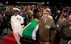 Members of the South African military carrying the coffin of Nelson Mandela