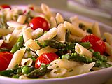Giada Penne with Asparagus & Cherry Tomatoes (spring) - Easy, fresh and yummy! I used 1/4 cup seasoned fire roasted tomatoes from the deli diced small instead of cherry tomatoes, frozen peas worked fine and I didn't need to use the reserved pasta water.
