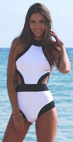 Its classic tones of black and white have you set for a swim at any time, and its cutout detail makes this one piece all the sweeter to wear. Check out the look at CUPSHE.com