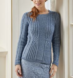 Gloriously feminine, this jumper by Pat Menchini uses Celtic-inspired knot cabling to add shape to the waist and wrists. The cable motifs incorporate long sections of ribbing, which will flatter your figure. The fabric feels soft and warm, thanks to the aran-weight yarn from Wendy, called Purity. It's formed from a cotton chainette with an air-puffed merino wool interior; this unusual construction makes the yarn feel incredibly light and soft.