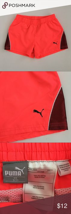 Puma Neon Pink Lined Athletic Shorts S 7 Puma Neon Pink and Black Athletic Shorts!  -Girls Size Small (7) -Features elastic waistband and mesh lined interior  -Preloved in excellent condition with no major signs of wear (see photos) -Running, Workout, athleisure, casual Puma Bottoms Shorts