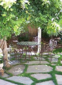 Cute Flagstone Patio with Grass also A Set of Vintage Wrought Iron Dining Table and Chairs on Bronze Look Paint Colours Above Flagstone Pavers with Grass In Between from Backyard Patio Ideas Pergola Patio, Patio Table, Backyard Patio, Backyard Landscaping, Iron Pergola, Pavers Patio, White Pergola, Dining Table, Pergola Canopy