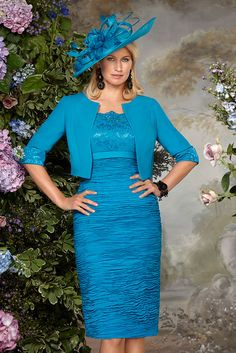70833 (Condici) Ruched Georgina dress with bolero jacket in Rich Teal. The dress has pretty lace capped sleeves and intricate beaded detailing around the neckline. The skirt is ruched and the length will sit below the knee. The matching Crepe Read More...