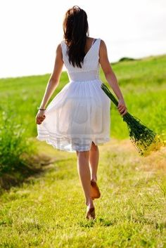 Google Image Result for http://us.123rf.com/400wm/400/400/warrengoldswain/warrengoldswain1102/warrengoldswain110200019/8726283-white-dress-skipping-girl-in-field-with-flowers-at-sunset.jpg