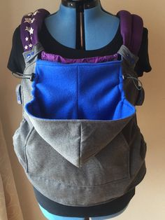 Add an extra layer of warmth to your babys soft structured carrier with a Snap On Hoodie! Made from fleece with an adjustable hood and a fleece lined pocket to keep your hands warm too. The hoodies snap on to the straps and waistband of your carrier for easy wearing and removal. You