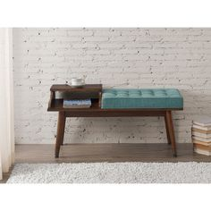 This mid-century inspired bench is perfect in just about any space. It features seating and storage in aqua colored upholstery and a light walnut wood finish all topped off with antique gold metal foo