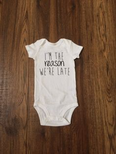 """I'm the Reason We're Late"" Onesie"