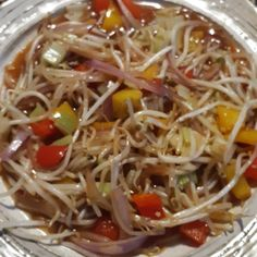 Cook 2 chicken breasts with salt, pepper, garlic powder in a large skillet.  Add to the skillet:  1 red bell pepper 1 yellow bell pepper 2 cups bean sprouts   2 chopped celery stocks 1/2  red onion, sliced 1 jar of HP sweet and sour sauce 2 tbsp sesame seeds  Cook until heated. SERVE