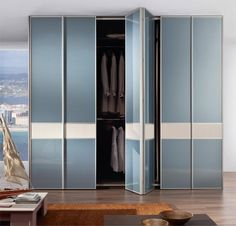 Bi-folding light blue and beige glass doors