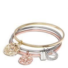 Coach Signature C Disc Bangle Set (2 105 UAH) ❤ liked on Polyvore featuring jewelry, bracelets, charm bangle, bangle bracelet set, bangle charm bracelet, charm bracelet jewelry and bracelet jewelry