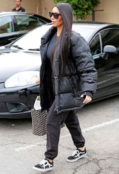Mrs. West stepped out near her home in Los Angeles rocking what might be her most casual look to date—a black top and coordinating sweatpants that she topped off with an oversize puffer coat. A monogrammed tote, black-and-white Vans sneakers, and dark sunnies completed her outfit.