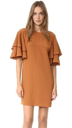 ¡Cómpralo ya!. Tibi Ruffle Sleeve Shift Dress - Amber Brown. Ruffled half sleeves lend a feminine touch to this minimalist Tibi shift dress. Tie back keyhole. Lined. Fabric: Silk crepe. Shell: 100% silk. Lining: 100% polyester. Dry clean. Imported, China. Measurements Length: 33in / 84cm, from shoulder Measurements from size 2. Available sizes: 0,2,4,6,8,10 , vestidoinformal, casual, informales, informal, day, kleidcasual, vestidoinformal, robeinformelle, vestitoinformale, día. Vestido…