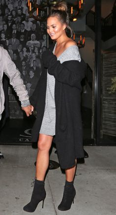 Chrissy Teigen in a gray T-shirt dress, long gray cardigan and black booties  - click through for more fall outfit ideas from celebrities!