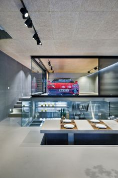 elevated dining table Split Level Hong Kong House Centered Around a Red Ferrari