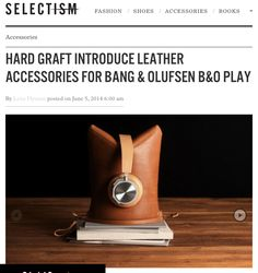 A rather interesting side project from the Hard Graft crew as they create a set of leather accessories to help keep your Bang & Olufsen BeoPlay gear safe. Two models are currently available. The PEAK, a soft pouch with enough room for your headphones and smaller gadgets such as the iPad mini, doubles as a stand when turned upside down, available in either tan or black Italian leather.