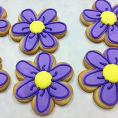 Purple flower cookies.... Repinned By:#TheCookieCutterCompany
