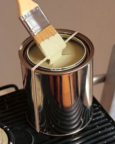 Prevent messy paint drips by using a rubber band to remove excess paint from your brush.