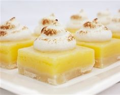 Lemon bites with toasted meringue topping on buttery shortbread crust
