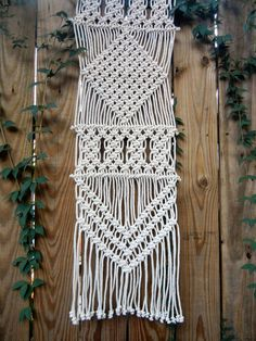 Add texture to your table with this modern macramé table runner. This piece is handwoven using 1/8 3 strand cotton rope in a natural color and