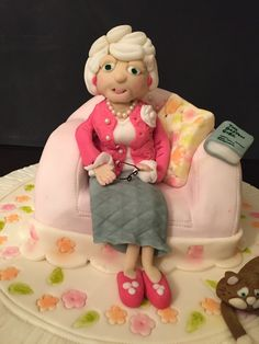 Lady of Leisure... Chair is made of chocolate cake with chocolate ganache and covered with fondant. Figures are modelled from fondant/gum paste