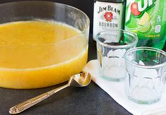 Bourbon Slush  9 cups water  2 cups granulated sugar  1 (12-ounce) can frozen orange juice concentrate  1 (12-ounce) can frozen lemonade concentrate  2 cups bourbon  Fresca, Sprite or 7UP for serving