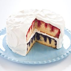 Independence Day Red, White & Blue Poke Cake! Flavored gelatin and fresh berries give white cake layers stripes of ruby red and berry blue.
