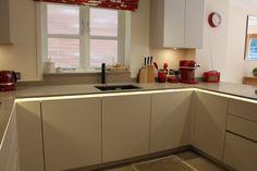 ALNO kitchen by Phil Harflett from ALNO Bristol. LED lighting under worktop on handleless kitchen
