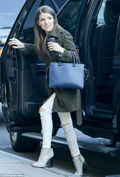 City style: The Up In The Air star donned ripped jeans and a green coat as she exited a ca...