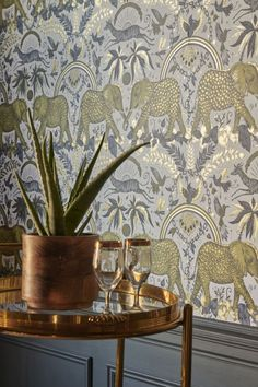Inspired by Emma J Shipley's travels to Botswana, striking leopard-spotted elephants take centre stage in this amazing wallpaper design. Elephant Wallpaper, Print Wallpaper, Animal Wallpaper, Funky Wallpaper, Amazing Wallpaper, Hallway Wallpaper, Feature Wallpaper, Gold Wallpaper Living Room, Wallpaper Toilet