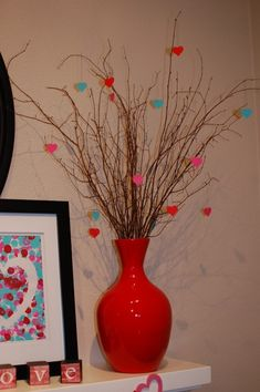 Branches with hearts- 18 Romantic DIY Home Decor Project for Valentine's Day
