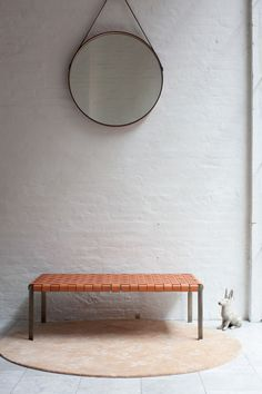 leather woven bench and round mirror