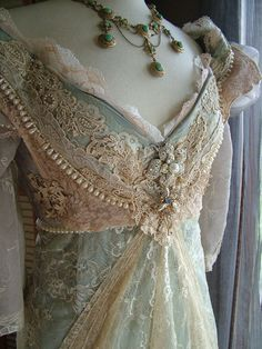 Wow! So pretty! I can't believe how intricate the lacing and beading is on this dress! that would take sooo long to do. Love this though. It's very pretty.