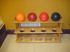 Homemade bowling ball rack. Use a hole saw to cut 4-inch diameter holes. Then router the edges with a chamfer bit.