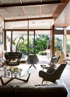 Can you name the 3 iconic chairs in this picture? Click on the image to see more mid-century modern designs