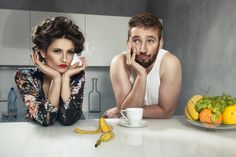 Photograph Funny couple after breakfast. Strange faces. Young man and beauty woman in kitchen by artur k on 500px