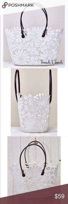 Kora Daisy Lace Tote Fabulous white crochet daisy lace tote bag. A perfect addition to your summer wardrobe. Such a versatile piece. Carry it to the beach, carry it to the gym, great as a catch all tote for running errrands too. Go girly and wear it on date night.  Coated floral crochet lace tote bag with scallop finish and vegan leather straps details. 70% POLYESTER, 30% RESIN Bags Totes