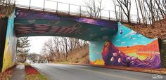 """Street Artist Creates An 'Underpass Illusion' In New York - DesignTAXI.com New York-based street artist Dasic painted this impressive mural that spans the ceiling and walls of an underpass in Newburgh, New York.   Calling it an """"underpass illusion"""", Dasic's work is colorful and vibrant, and is best viewed standing away from the walls."""