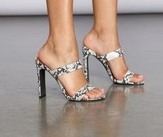 An easy but always sexy go to look! These must have mule heels feature a snake print, a two strap upper, and a wide stiletto heel. Louboutin Shoes Price, Fin Fun Mermaid, Stiletto Heels, High Heels, Chanel West Coast, Skai Jackson, Butterfly Nail, Beautiful Toes, Cute Heels