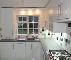 White Kitchen Grey Worktop large soft white/light cream high gloss kitchen, black granite