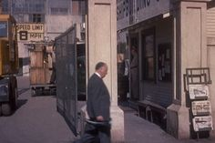 """""""Vertigo"""" (1958) - The last of Hitchcock's musically-themed appearances sees him clutching a horn case as he passes in front of San Francisco's Mission District Shipyard."""