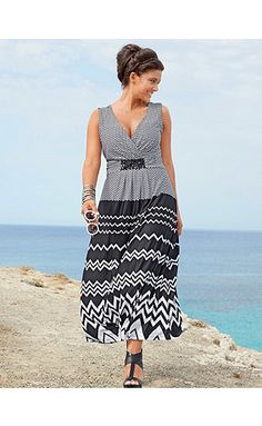 Dress in a chevron pattern. Decorative beads below the surplice V-neckline and flared skirt. Sleeveless. <br />