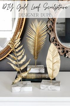 How to make a knock-off gold leaf sculpture using faux leaves, spray paint, scrap wood, and marble contact paper for a designer look for less.