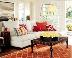 so much color in this room, even with white walls and a white couch