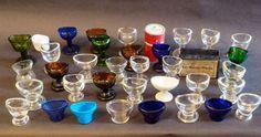 Verzameling optometrische oogglazen of oogbad van diverse materialen