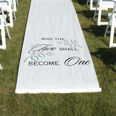 "White or black fabric aisle runner features ""And The Two Shall Become One"" design in black or white. Leaves are printed in white or grey. 36"" x 100"" long with pull cord. Design is printed 8"" form the"