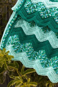 Green ripple crochet blanket with simple double crochet border. Change up your increases/decreases for a steeper ripple!