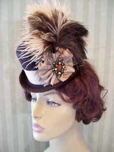 Steampunk Hat Victorian Mini Top Hat  Kentucky Derby Hat Lolita Hat Neo Victorian Hat Photo Prop. $36.99, via Etsy.