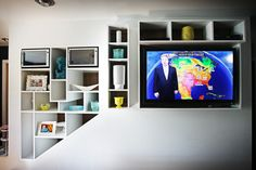 tv with built in shelving